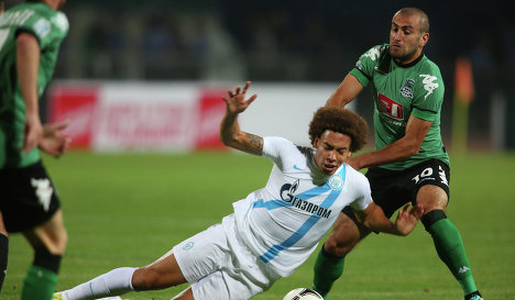 Zenit football player  Axel  Witsel (left) and FC Krasnodar  football player  Yura Movsisyan (right)