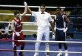Бокс. .  1/4 финала. .  Весовая категория до 51 кг.  Россиянин Георгий Балакшин (красная форма) в четвертьфинале...
