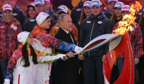 Vladimir Putin lights the flame