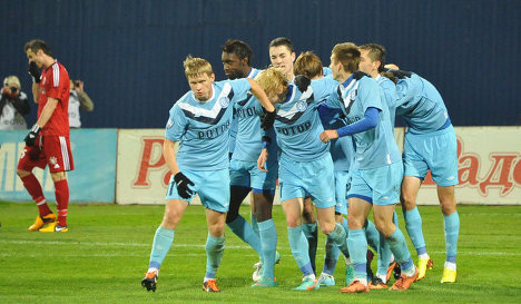 Rotor Volgograd players celebrate a goal.