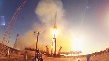 Traveling into Outer Space on an Olympic rocket: the Olympic Torch Heads into Orbit from Baikonur