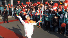 Hundreds of students welcome the Olympic flame at Russky Island