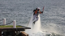 Jetpack torchbearer carries Olympic Flame from the waters of Lake Baikal