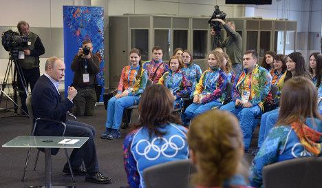 Russian President Vladimir Putin meets Olympic volunteers