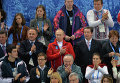 Vladimir Putin (in red coat)