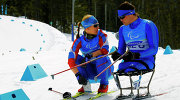 Russian sit skiers Anna Burmistrova and Irek Zaripov training for the Paralympics