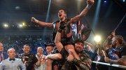 Россиянин Дмитрий Чудинов радуется победе в бое за титул чемпиона мира по версии WBA
