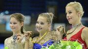 Российские фигуристки Юлия Липницкая и Елена Радионова и американка Эшли Вагнер.